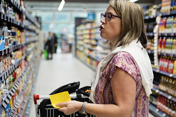 Mature Woman Shopping In Supermarket. Photograph by Martinedoucet