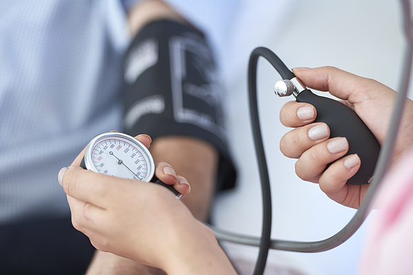 Measuring blood pressure Photograph by Stockvisual