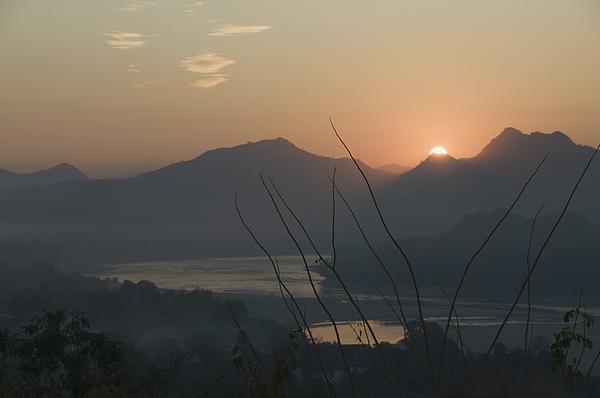 Mekong River at sunset, Luang Prabang, Laos, Indochina, Southeast Asia, Asia Photograph by Robert Harding / robertharding