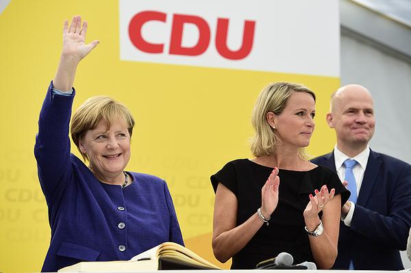 Merkel Campaigns In Delbruck Photograph by Alexander Koerner