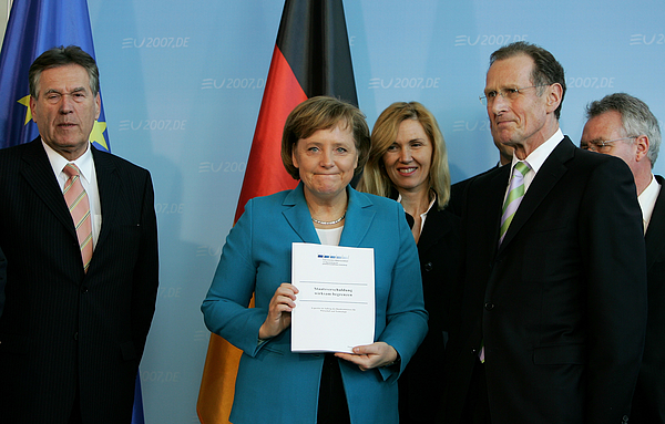 Merkel Receives Economic Experts Council Report Photograph by Andreas Rentz