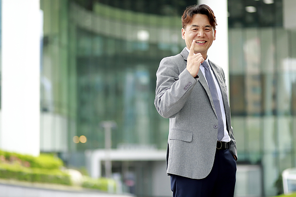Middle Aged Businessman Pointing Finger Outdoors Photograph by Runstudio