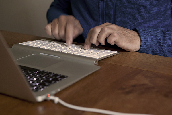 Midsection Of Man Using Laptop In Table Photograph by Paulien Tabak / EyeEm