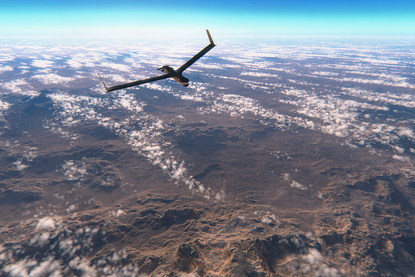 Military surveillance drone flying over rocky deserts Photograph by Gremlin