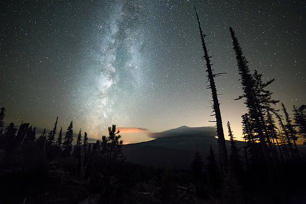 Milky way over a shrouded Mt. Hood and night sky with stars Photograph by Tyler Hulett
