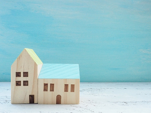 Miniature House Standing With Wooden Sky Blue Background Photograph by Poteco