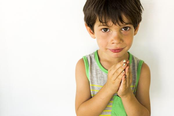 Mixed race boy wearing nail polish Photograph by Adam Hester
