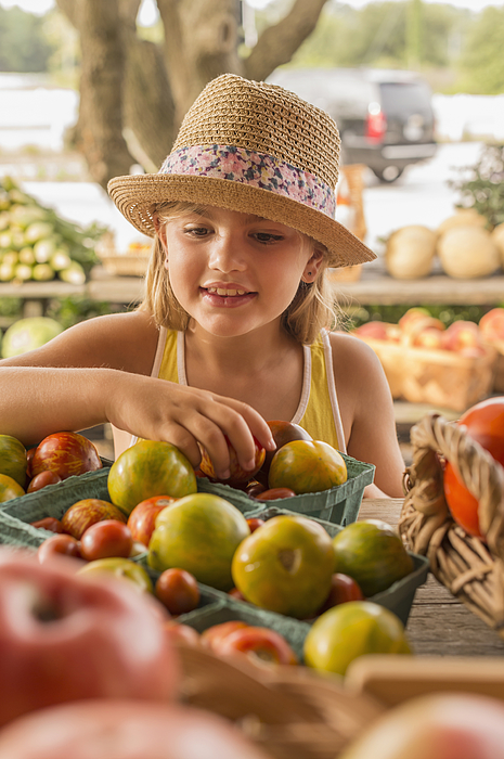 Mixed race girl browsing produce at farmers market Photograph by Mark Edward Atkinson/Tracey Lee