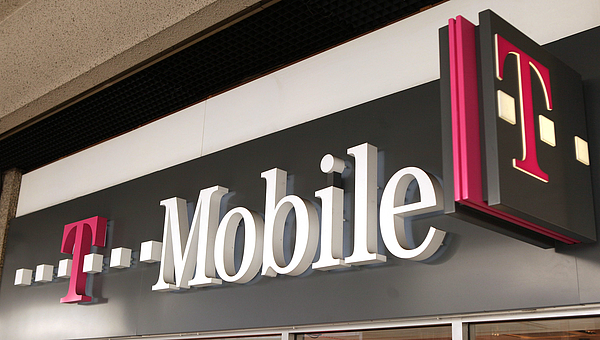 Mobile Phone Companies Agree To UK Business Merger Photograph by Peter Macdiarmid