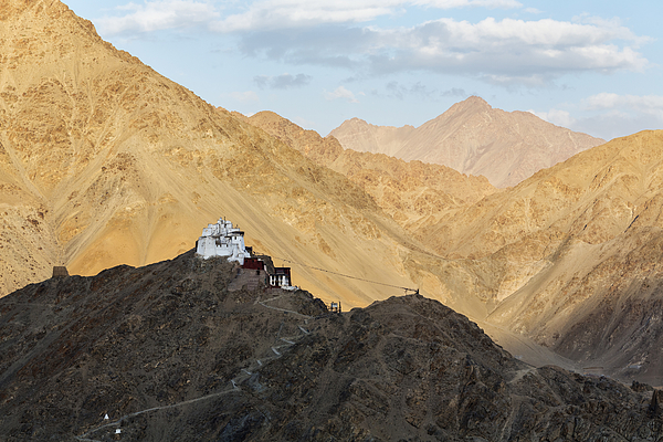 Monastery on rocky hilltop in remote mountain valley, Leh, Ladakh, India Photograph by Jeremy Woodhouse