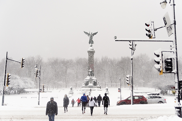 Montreal city park with people enjoying snow storm. Photograph by Martinedoucet