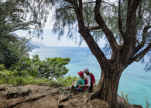Mother and daughter hiking Na Pali Coast Photograph by Per Breiehagen