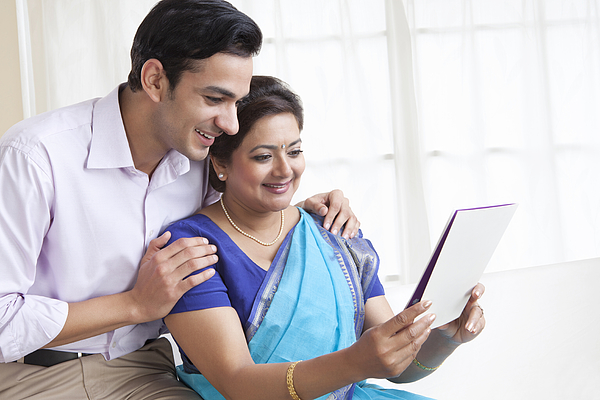 Mother and son reading a greeting card Photograph by Ravi Ranjan