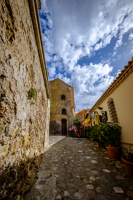 Narrow alley and old houses with plants outside in Castelmola Taormina Sicily Italy Photograph by Finn Bjurvoll Hansen