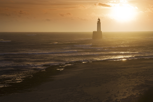 North Sea Lighthouse And Beach At Dawn Photograph by Theasis