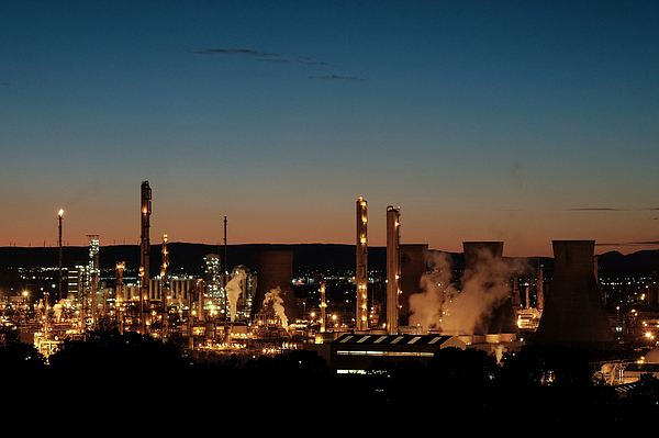 Oil refinery at dusk Photograph by Bob Last