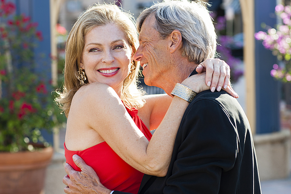 Older Caucasian couple hugging outdoors Photograph by Kevin Dodge