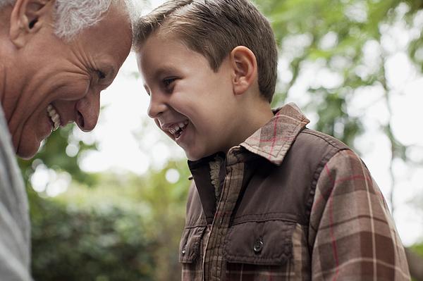 Older man and grandson smiling together Photograph by Sam Edwards