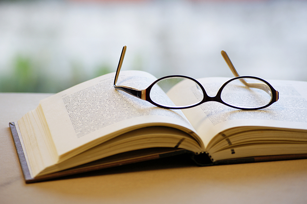 Open book and glasses Photograph by Gregoria Gregoriou Crowe fine art and creative photography.