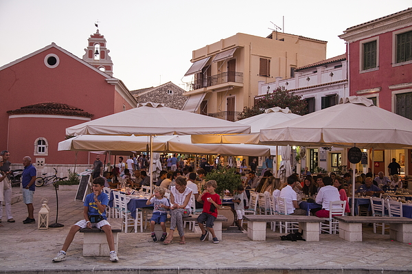 Outdoor restaurant seating in Old Town at sunset Photograph by Holger Leue