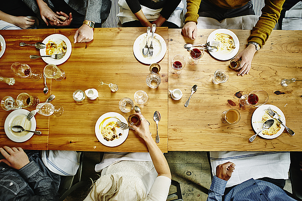 Overhead view of friends at table during party Photograph by Thomas Barwick