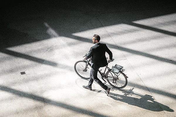 Overhead View On Elegant Businessman Going With Bycicle In City Photograph by Golero