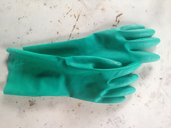 Pair Of Green Washing Up Gloves On Floor Photograph by Barbara Sommerer / EyeEm