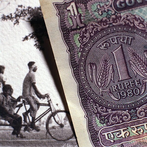 Paper Bill Next To Old Photograph. Photograph by Christian Zachariasen