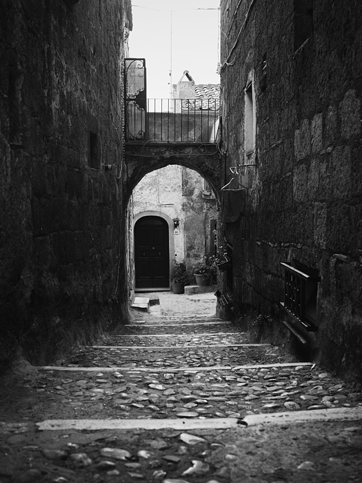 Passage Leading Towards Arch Amidst Houses Photograph by Lorenzo Viola / EyeEm