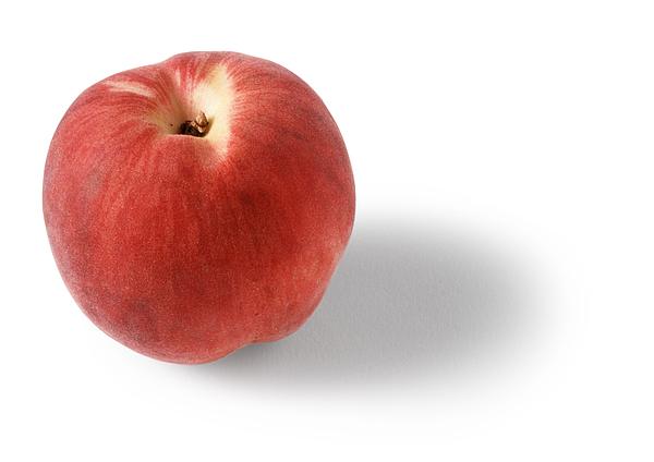 Peach, white background Photograph by Isabelle Rozenbaum
