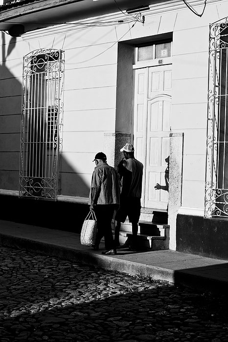 Pedestrians with sunset light on street Photograph by Merten Snijders