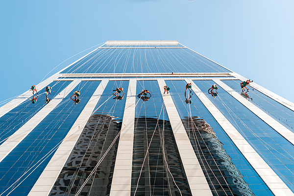 People Cleaning the City Building / Dubai, UAE Photograph by AerialPerspective Images