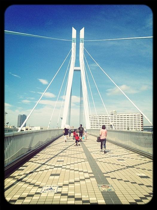 People Crossing Footbridge Photograph by Sherry Wei / EyeEm
