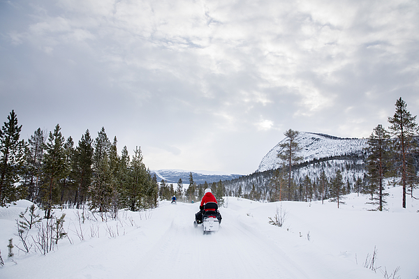 People Drive Snowmobiles On A Mountain In Rural Norway, Wintertime Photograph by Morten Falch Sortland