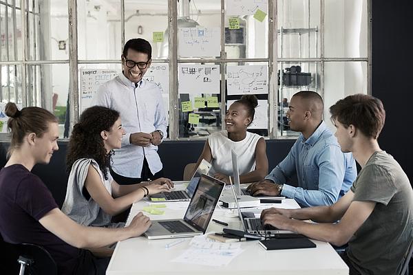 People having meeting in creative office Photograph by Robin Skjoldborg