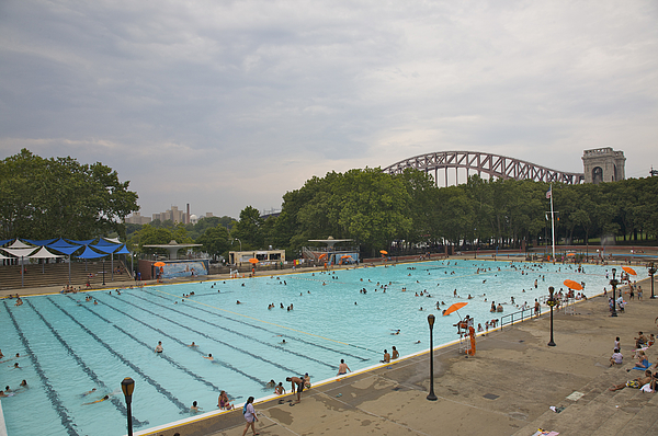 People in Astoria Pool in Astoria Park beneath Hell Gate Bridge, Astoria, Queens, NY Photograph by Barry Winiker