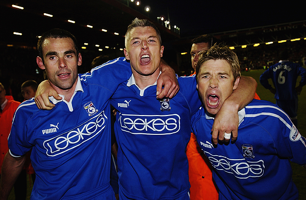 Peter Thorne, Graham Kavanagh and Andy Legg of Cardiff City celebrate Photograph by Stu Forster