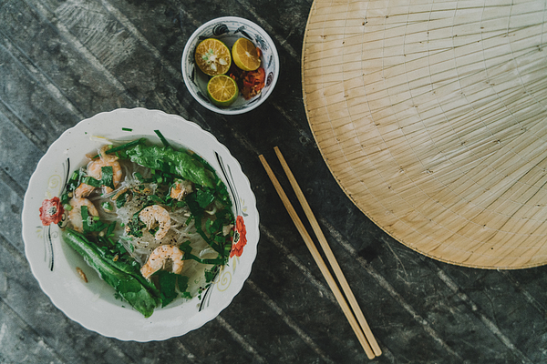 Pho with shrimp on the table near Asian conical hat Photograph by Oleh_Slobodeniuk