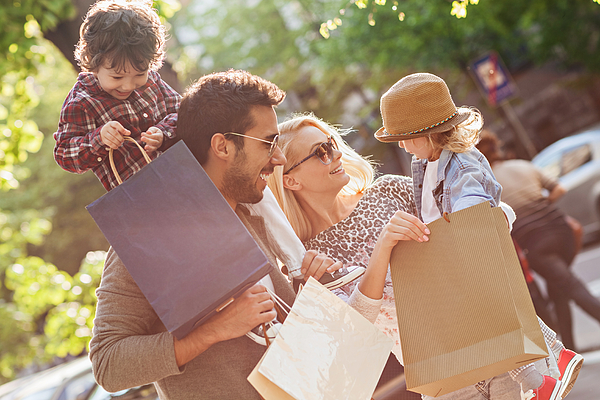 Photo of a young beautiful family enjoying shopping Photograph by Geber86