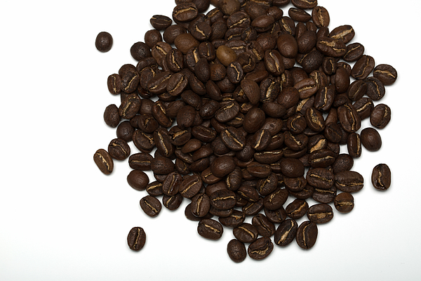 Pile of Coffee beans on a white background Photograph by Jean-Marc PAYET