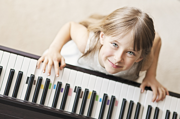 Playing The Digital Piano Photograph by Imgorthand