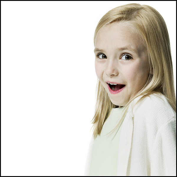Portrait Of A Blonde Female Child As She Flashes A Surprised Look At The Camera Photograph by Photodisc