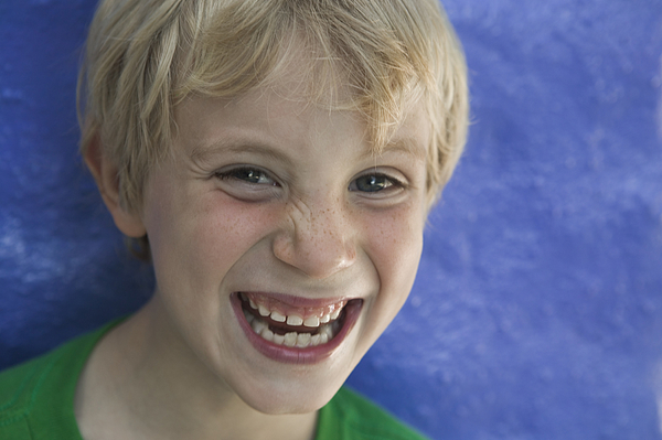 Portrait Of A Boy Laughing Photograph by Photodisc