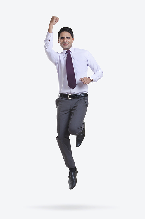 Portrait of a male executive jumping in the air Photograph by Sudipta Halder