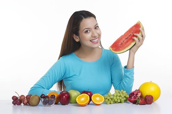 Portrait of a woman holding a watermelon Photograph by Sudipta Halder