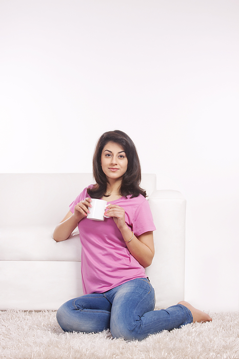 Portrait of a woman with a mug of tea Photograph by Sudipta Halder