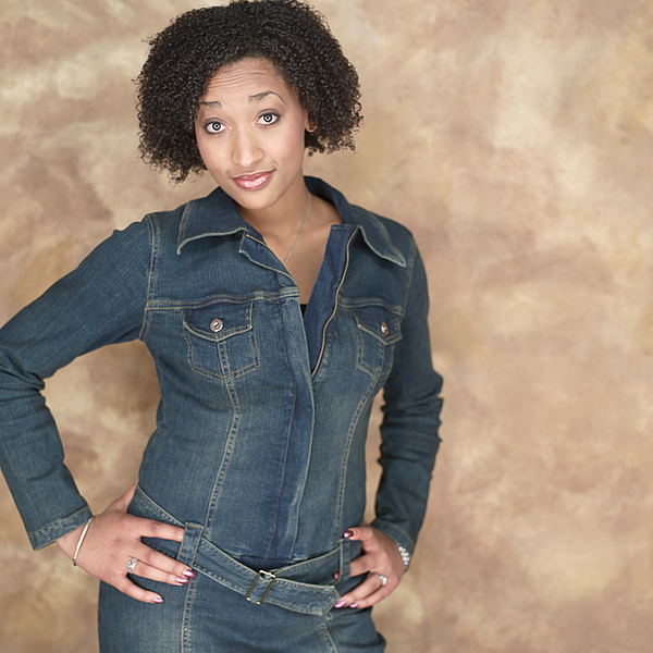Portrait Of A Young Attractive African American Woman In A Denim Outfit As She Flashes Some Attitude Photograph by Photodisc