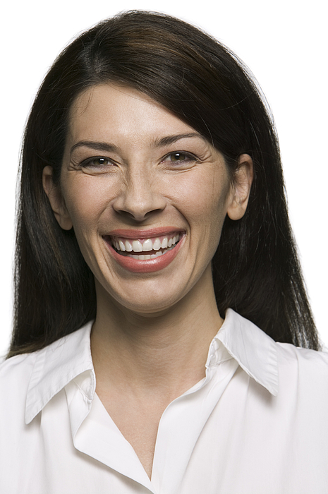 Portrait Of An Attractive Adult Brunette Woman As She Smiles Brightly At The Camera Photograph by Photodisc