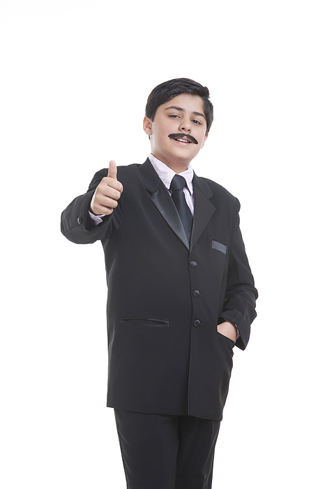 Portrait of boy dressed as businessman giving thumbs up Photograph by Sudipta Halder