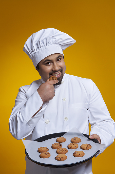 Portrait of chef eating a cookie Photograph by Ravi Ranjan